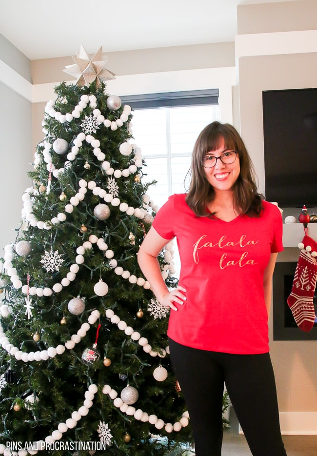 This DIY Christmas shirt is so cute! It's a perfect Christmas craft. You can make this shirt using a Cricut Explore Air and Iron on Vinyl. It is super cute and festive. It makes a great gift idea!