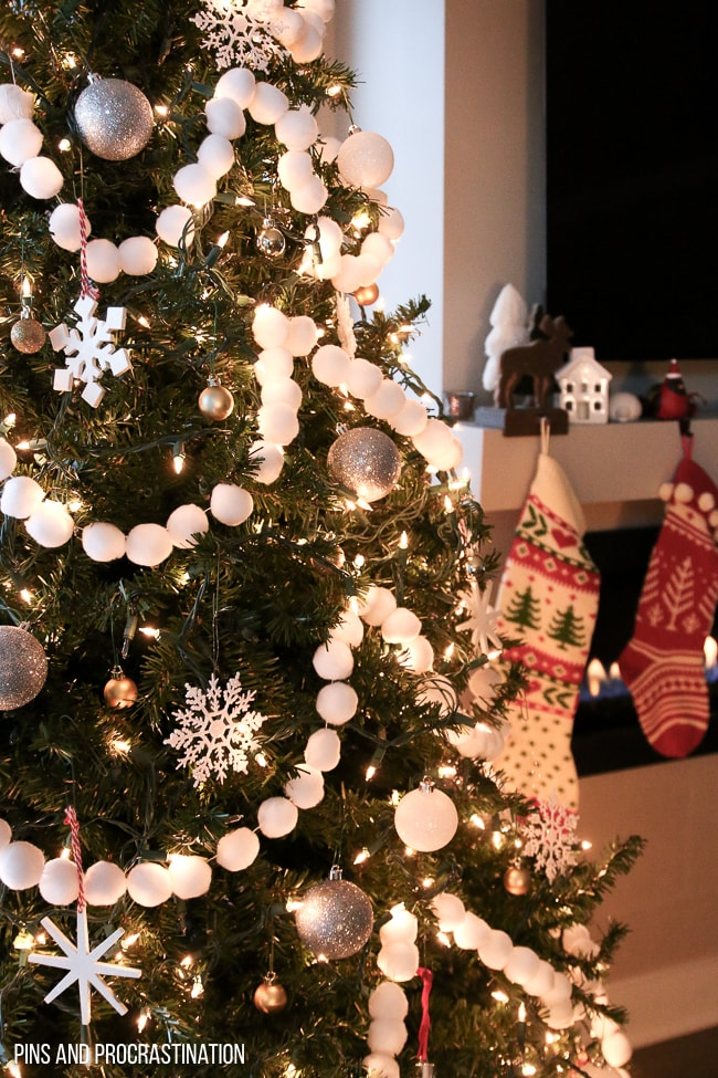 If you're looking for a fun, easy, and adorable Christmas craft, look no further. This pom pom garland is so easy to make, and it looks great on the tree. It is the perfect festive Christmas craft. It makes my tree look so happy and unique! And it really couldn't be any easier to make. So much cuteness from so little effort! It makes such great Christmas tree decor!